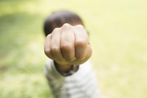 The boy put the fist