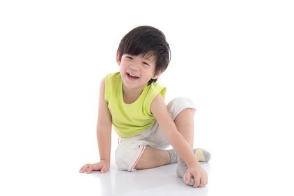 Happy asian boy sitting