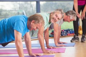 Three men doing press-ups at the gym
